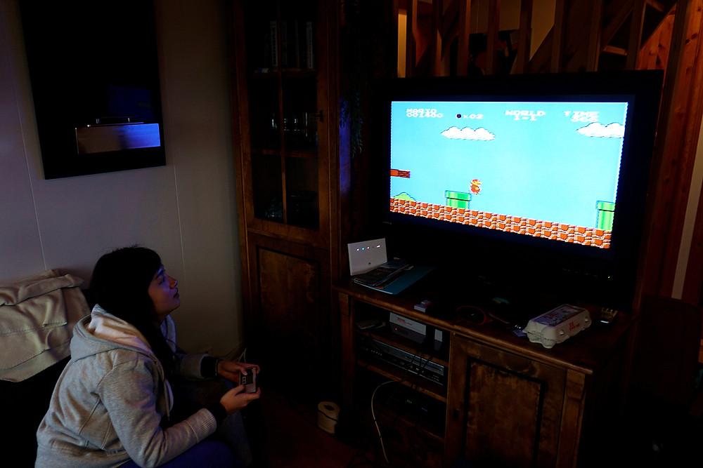 Having fun with classic Super Mario game.