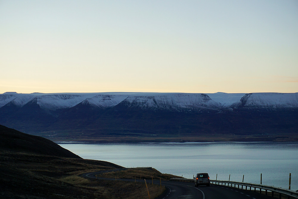 Opposite flat mountain range looks like it is cut horizontally.