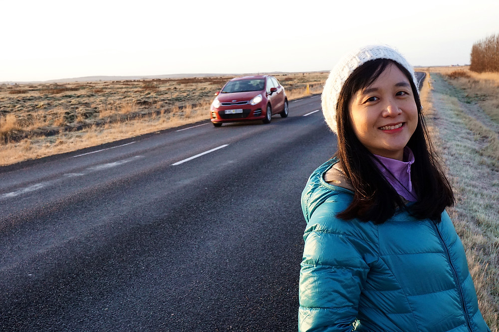Sue hui ask for the take with the car approaching.