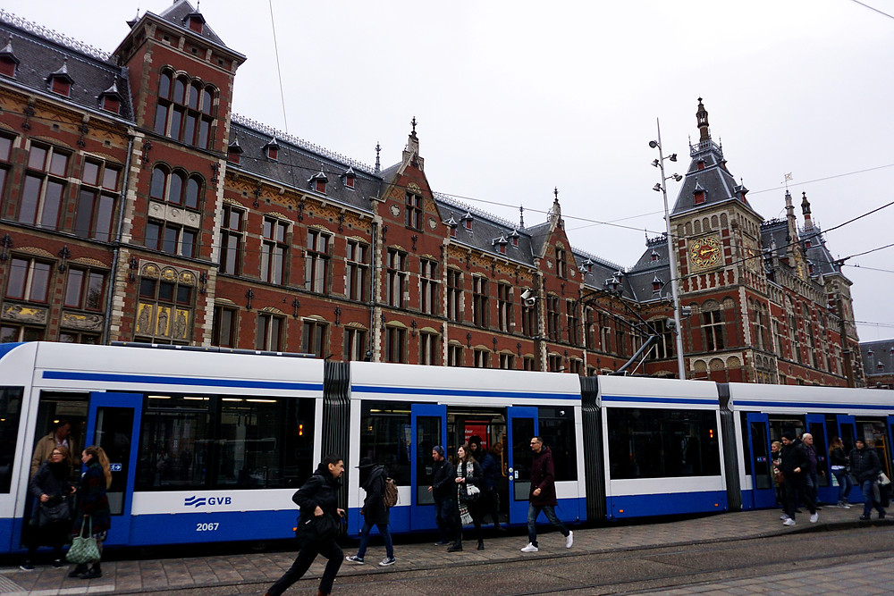 Inner city tram in front of Amsterdam central station.