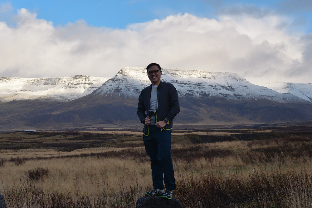 Me with the mountain range of Esja. Photo credited to Hybrid.