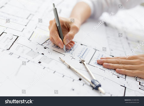 stock-photo-architect-working-on-bluepri