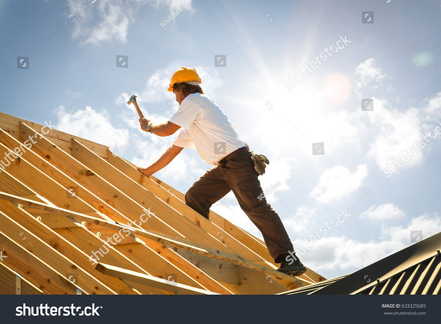 stock-photo-roofer-working-on-roof-struc