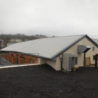Insulated roof panels to exisiting building