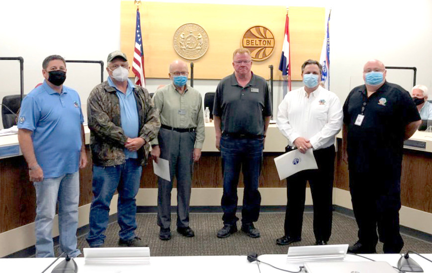 Belton Public Works Director Greg Rokos (second from right) accepts a proclamation from Mayor Norman Larkey (third from right) and Councilmember Robert Powell (third from left) in recognition of National Public Works Week during Tuesday's meeting of the City Council.