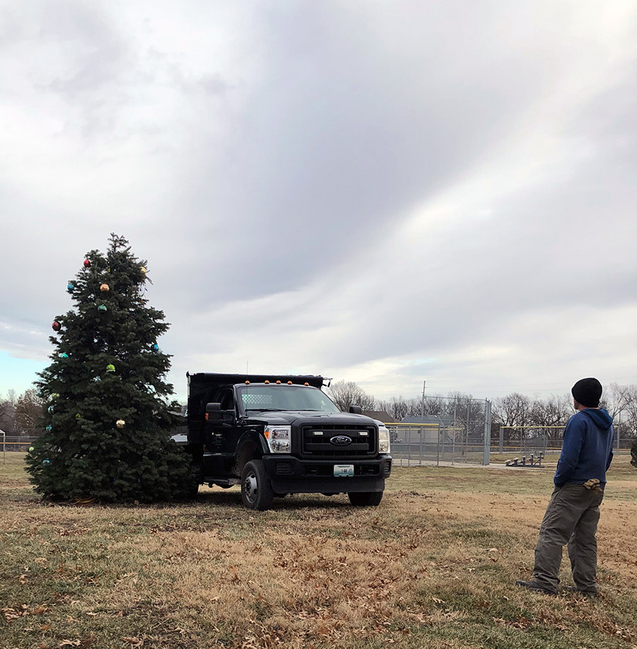 Belton Parks workers begin the process of salvaging the lights and ornaments that survived last weekend's vandalism of the Mayor's Christmas Tree in Memorial Park. Around half the lights are still operational, they said. Vandals ripped the top from the tree and stole the star in addition to numerous other ornaments and light strings.