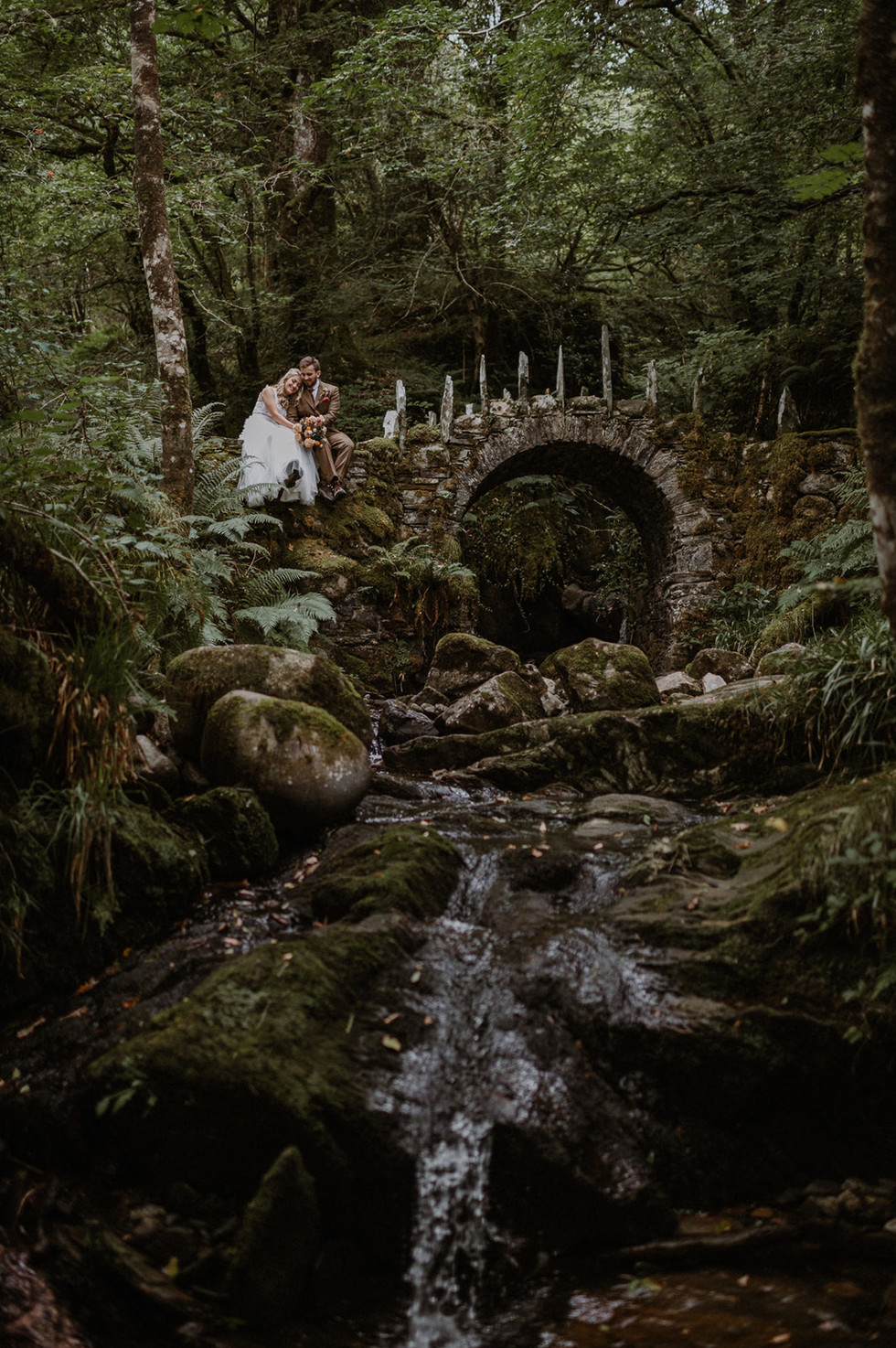 Bryony and Tom's elopement photo at The Fairy Bridge - Raini Rowell Photography