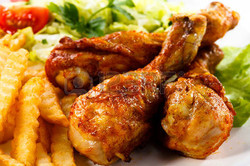 40049555-grilled-chicken-legs-with-chips-and-vegetables