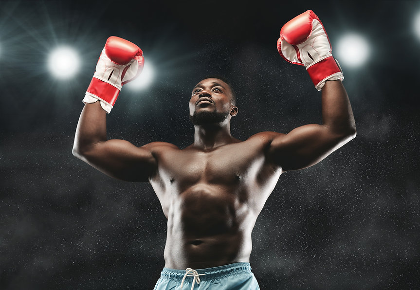 Champion. African boxer raising his arms