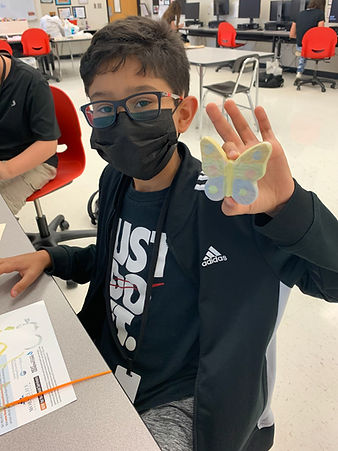 Photo of student with butterfly.jpg