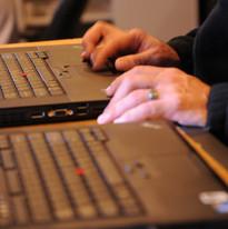 Service engineer John updating a laptop