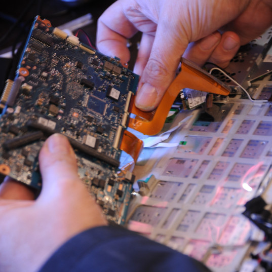 Service engineer John replacing a computer card