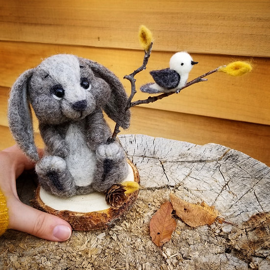 Charcoal bunny with bird on branch