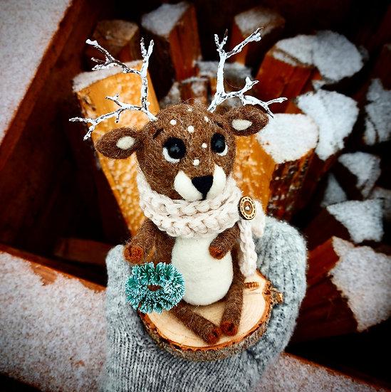Winter Reindeer holding Blue Spruce Wreath