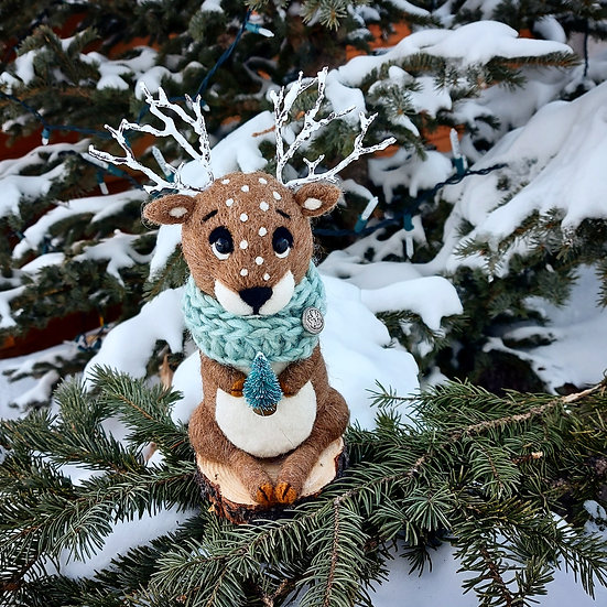 Reindeer with tiny Blue Spruce