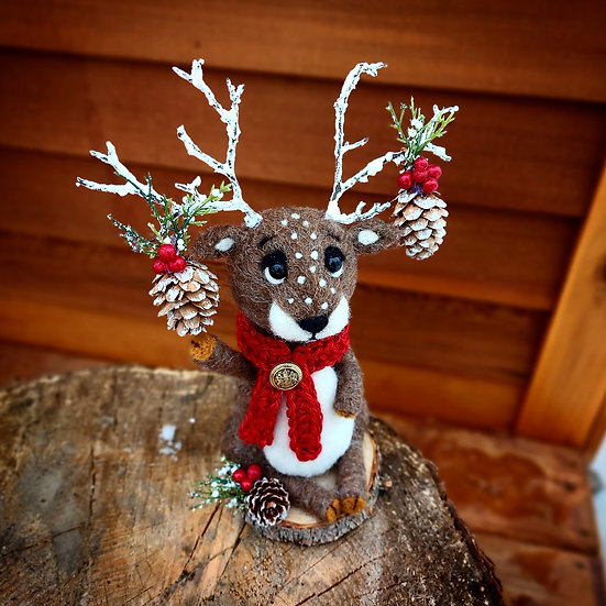 Christmas Reindeer with berries and pinecone