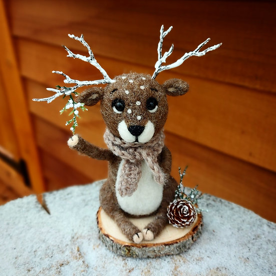 Winter Reindeer with Fosted Greenery