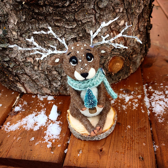 Christmas Reindeer with blue spruce