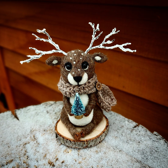 Winter Reindeer with Tiny Blue Spruce