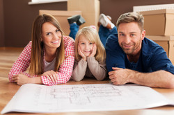 Happy-family-planning-their-new-apartment-000038527838_Large.jpg