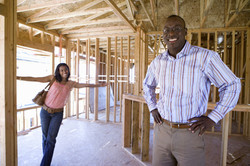 Woman-looking-at-businessman-in-partially-built-house-000047324788_Large.jpg