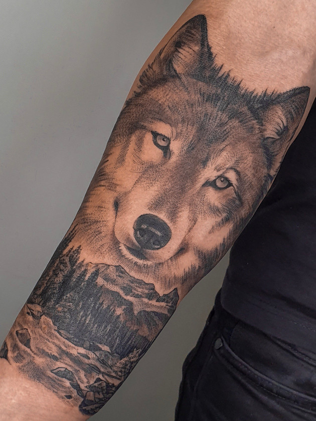 wolf and forest on forearm - black and white tattoo - black house tattoo prague