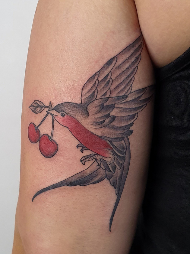 Tatouages japonais - Black House Tattoo Prague - pour homme - pour femme - avaler avec du glaçage - main pour femme