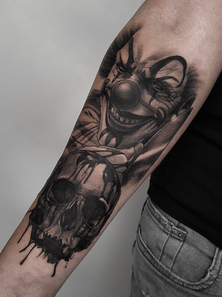 clown with skull on forearm- black and white tattoo prague