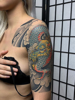 chinese dragon on shoulder - chinese tattoo - black house tattoo prague