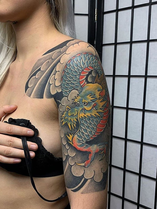 chinese dragon on shoulder - chinese tattoo - black house tattoo prague