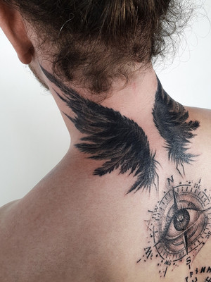 tattoo wings on neck from behind - celtic tattoo - black house tattoo prague