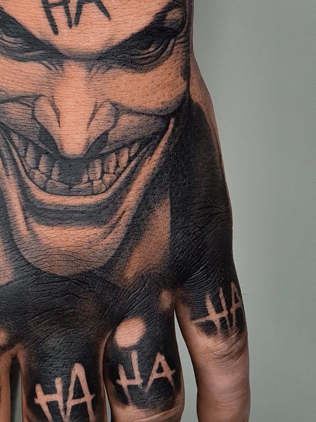 joker on hand - black and white tattoo - black house tattoo prague