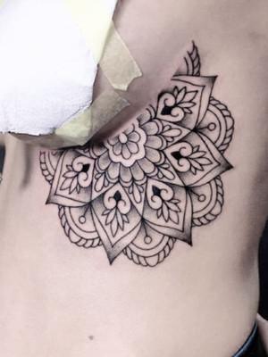 ornamental tattoo - mandala on ribs - black house tattoo prague