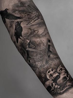 war on forearm - black and white tattoo - black house tattoo prague