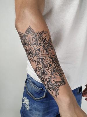 ornamental tattoo - mandalal on the fortress - black house tattoo prague