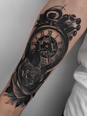 clock and roses on forearm - black and white tattoo - black house tattoo prague