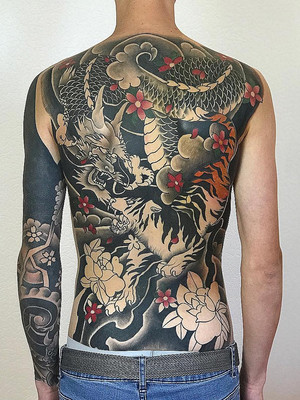 chinese dragon on back - chinese tattoo - black house tattoo prague