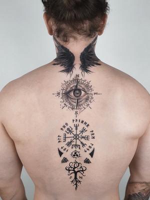 scandinavian tattoo on the back eye and wings - celtic tattoo - black house tattoo prague