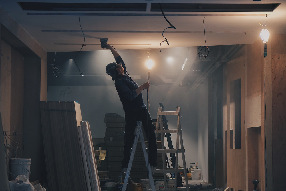 Man painting a ceiling