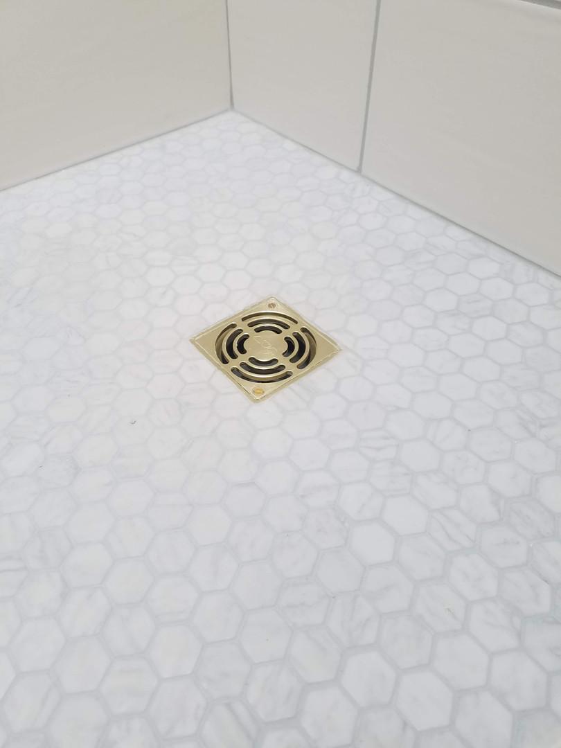 New Shower Floor-Matching Gold Drain