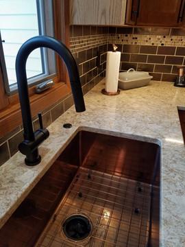Copper Sink & Black Faucet