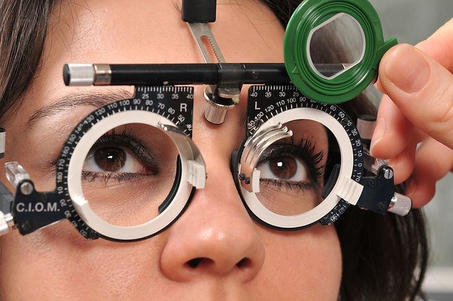 Female patient eye exam