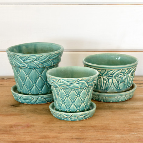 """assorted sizes, mccoy planters 4"""" to 5"""" tall  5. ea  qty. 6"""