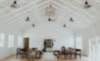 white interior wedding venue