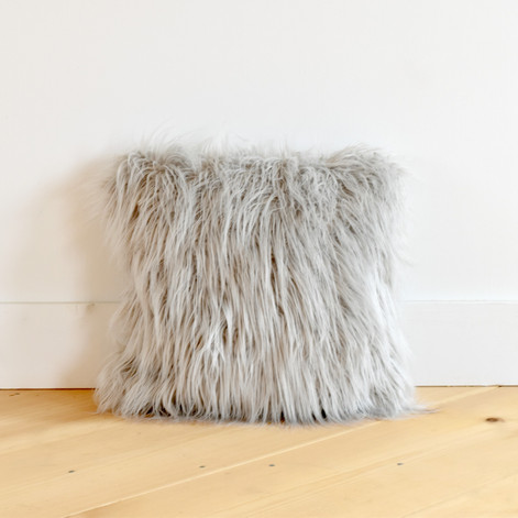 light gray furry pillow