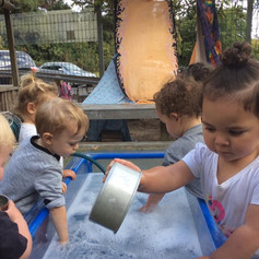 playing in the water at Te Akonga ELC