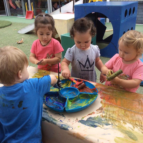playing with paint at Te Akonga ELC