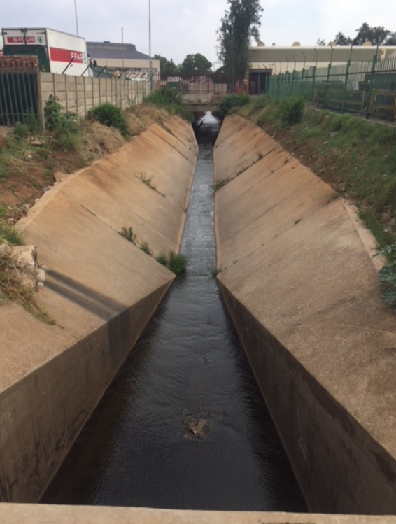 The Clayville tributary is canalised as it flows through Clayville.
