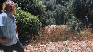 Heap of rubbish over 100 metres long caught in a bend of the Hennops River