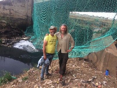 River activists block garbage with net to save Hennops river